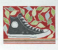 High top sneaker and leaves